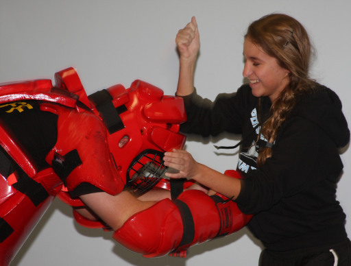 Woman attacking man in red squishy protective outfit